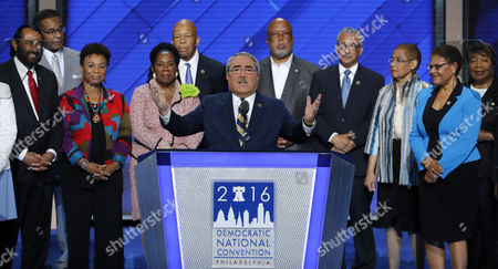 Congressional Black Caucus Chairman Rep. G. K. Butterfield, D-NC., stands with members of the caucus as he speaks during the third day of the Democratic National Convention in Philadelphia