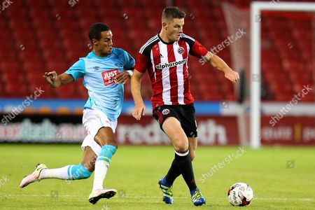 Tom Ince of Derby County chases Jack O'Connell of Sheffield United