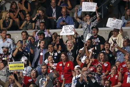 Activists protest as Former Defense Secretary Leon Panetta, speaks during the third day of the Democratic National Convention in Philadelphia