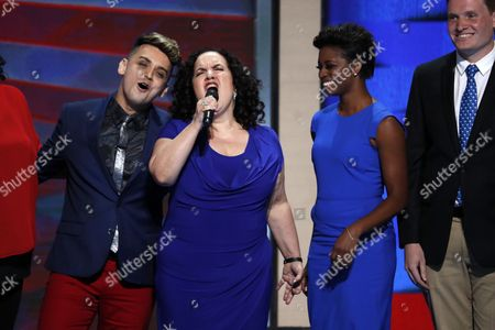 Stock Picture of Performers Michael Longoria, from left, Olga Merediz and Montego Glover appear on the third day of the Democratic National Convention in Philadelphia