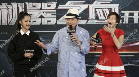 """Jackie Chan, center, and co-stars Erica Xia-Hou, right, and Nana Ou-Yang attend a press conference to announce the start of filming in Australia of his new film """"Bleeding Steel,"""" in Sydney, Australia"""