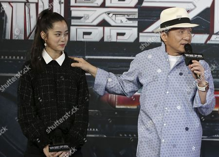 Jackie Chan, right, accompanied by co-star Nana Ou-Yang, speaks to the media during a press conference to announce the start of filming in Australia of his new film Bleeding Steel in Sydney, Australia