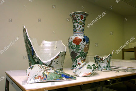 Two vases, one of which has been partially reassembled.