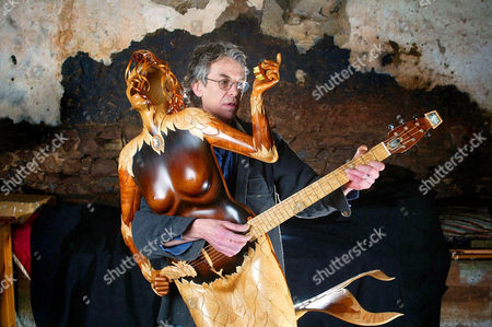Andy Manson with the Mermaid Guitar. The Mermaid is an intricate work of art, which also functions as a unique acoustic guitar. The combination of musical instrument and sculpture was made by renowned guitar maker Andy Manson Andy, from Crediton in Devon, has been building guitars for over 30 years. Mike Oldfield, Andy Summers (The Police), Ian Anderson (Jethro Tull) and John Paul Jones (Led Zeppelin) are among the stars who play his instruments. The Mermaid project took well over two years of Andy's time. He is aiming to sell it for £500,000.