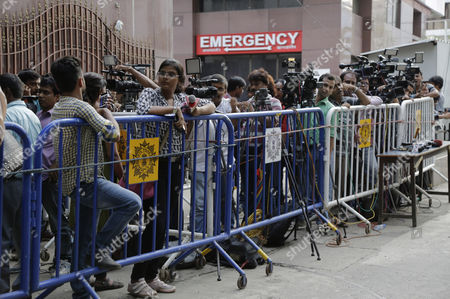 Media persons gather outside the hospital upon the demise of Indian writer Mahasweta Devi in Kolkata, India, . Devi, a well-known Indian writer and social activist, who used her writing to give voice to the oppressed poor tribal and forest dwellers, has died. She was 90. Devi had been in the hospital where she was being treated for a kidney ailment for the past two months, Press Trust of India said
