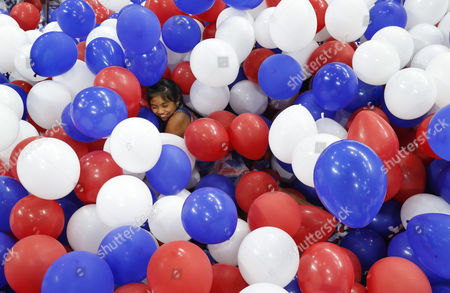 Stock Photo of Karla Ortiz, 11, of Las Vegas, dives into balloons on the floor after the Democratic National Convention in Philadelphia