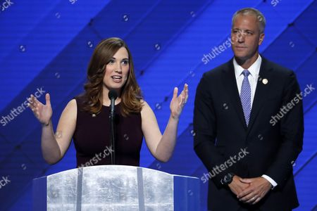 LGBT rights activist Sarah McBride speaks as Rep. Sean Patrick Maloney, D-NY, Co-Chair of the Congressional LGBT Equality Caucus listens during the final day of the Democratic National Convention in Philadelphia