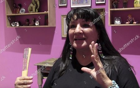 """Stock Image of Mexican-American author Sandra Cisneros talks about a new art exhibit based by her 1984 novel """"The House of Mango Street"""" at the National Hispanic Cultural Center in Albuquerque, N.M. """"The House on Mango Street: Artists Interpret Community"""" features major themes of the 1984 influential book, including hope, personal dreams, hardship, disillusionment, and family"""