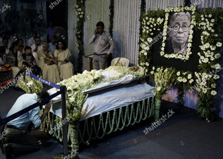 Stock Photo of Mourners gather near the body of Indian writer and social activist Mahasweta Devi in Kolkata,. Writing mostly in the Bengali language, Devi's major works dealt with the suffering of poor laborers and forest dwellers who had lost their lands due to industrial and urban growth. She founded several social organizations to help fight for the rights of indigenous people