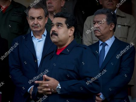 Spain's former Prime Minister Jose Luis Rodriguez Zapatero, left, looks at Venezuela's President Nicolas Maduro, as former Dominican Republic President Leonel Fernandez stands at righ