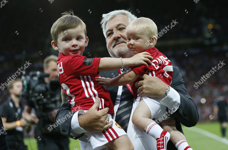 KIT AND KLAY ROONEY ARE REMOVED FROM PITCH BY SECURITY