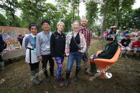Bird Hive - members of the Bird Hive team, including Sarah Allen, Lakes Alive Festival Director (blue jeans and black wellingtons), and Ben Robinson, Kendal Calling Director, while a festival-goer wears virtual reality goggles to experience a 360 degree virtual reality drone flight over the Lake District, a co-commission between Kendal Calling and Lakes Alive in support of World Heritage status for the Lake District