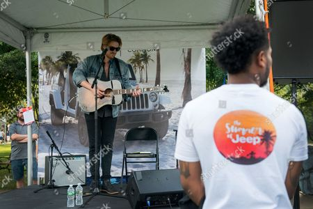 """Musician Jamie N Commons plays for fans at Jeep's """"Summer of Jeep"""" event at Navy Pier on , in Chicago"""