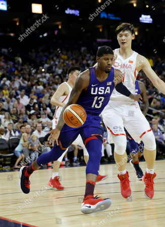 United States' Paul George drives during the first half of an exhibition basketball game against China in Oakland, Calif. While the men's basketball team's first order of business is to win the gold medal at the Rio Games there will be some other basketball business taking place on the court. Shoe business, and it can be get personal. Michael Jordan is the shining example of how on-court moments can take on another life through sneakers in this global multi-billion dollar industry. Kevin Durant, Kyrie Irving and other members of the United States Olympic men's basketball team could have a similar opportunity in Rio. George has been wearing the Nike Hyperdunk 2016 Flyknit