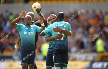 Wayne Routledge of Swansea celebrates his goal with Mo Barrow.