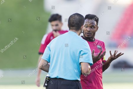 Stock Picture of Ottawa Fury FC midfielder Julian de Guzman (6) disagrees with Referee Juan Marquez during the match between Tampa Bay Rowdies and Ottawa Fury FC at TD Place in Ottawa, ON, Canada. Ottawa Fury FC won the match 2-0 for their third consecutive victory