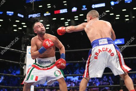 Stock Photo of Paul Malignaggi, left, dodges a punch from Gabriel Bracero during their fight at the Barclays Center in the Brooklyn borough of New York on . Paul Malignaggi won via decision
