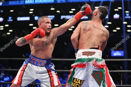 Gabriel Bracero, left, throws a punch at Paul Malignaggi during their fight at the Barclays Center in the Brooklyn borough of New York on . Paul Malignaggi won via decision