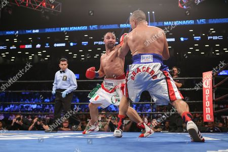 Paul Malignaggi, center, in action during his fight against Gabriel Bracero at the Barclays Center in the Brooklyn borough of New York on . Paul Malignaggi won via decision
