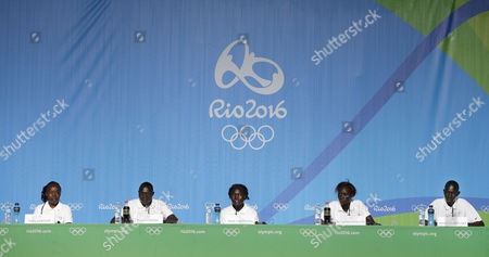 Members of the Refugee Olympic Team, from left, delegation head Tegla Loroupe, and athletes Paulo Lokoro, Rose Lokonyen, Anjelina Lohalith, and James Chiengjiek give a press conference in Rio de Janeiro, Brazil