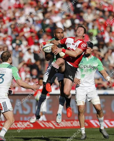 Highlanders's Patrick Osborne, top left, and Lions Ruan Combrinck, jump for the ball during a Super Rugby semifinal match at Ellis Park stadium in Johannesburg, South Africa, . Lions beat Highlanders 42-30
