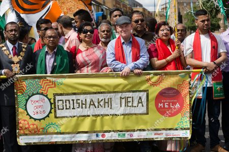 Mayor of Tower Hamlets, John Biggs joins colourful performers who dance and take part in the Boishakhi Mela street festival, which processes through Brick Lane in London's Banglatown.