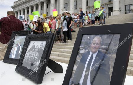 Family photographs of Josh Holt, an American jailed in Venezuela, are shown during a rally at the Utah State Capitol, in Salt Lake City.