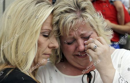 Laurie Holt, right, the mother of Josh Holt, an American jailed in Venezuela, is comforted by family friend Lori Fitch, left, as she cries during a rally at the Utah State Capitol, in Salt Lake City.