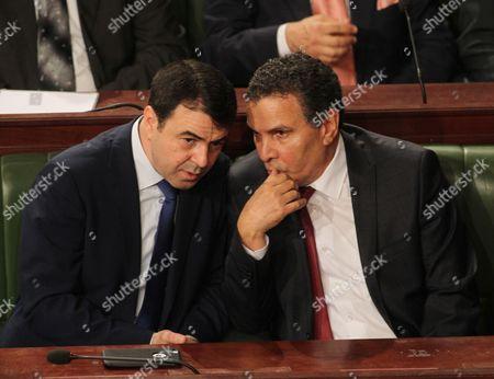 Tunisian Interior Minister Hedi Majdoub (L) greets Defence Minister Farhat Horchani (R)