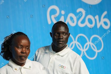 Rio de Janeiro, Brazil - 07/31/16 - RIO 2016 REFUGEES - The chef de mission of the Olympic Refugee Team, former Kenyan marathon world record-holder Tegla Loroupe and Paulo Lokoro from South Sudan attends a news conference at the Main Press Centre (MPC) at Olympic Parc Barra