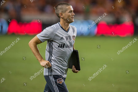 Houston Dynamo head coach Wade Barrett leaves the field after the 1st half of an MLS soccer match between the Houston Dynamo and the San Jose Earthquakes at BBVA Compass Stadium in Houston, TX. The game ended in a 1-1 draw