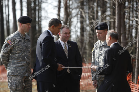 Stock Photo of United States President Barack Obama, Virginia Governor Tim Kaine look at a map of the Construction site of Fairfax County Parkway connector, surrounded by Colonel Jerry Blixt (L), Colonel Mark Moffatt (2R) and Director of the North Atlantic Division of the US Army Corps of Engineers James Stuart Turkel, Springfield
