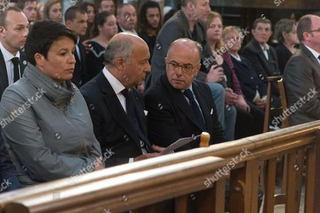 Stock Image of French Junior minister for Local Authorities Estelle Grelier, Laurent Fabius, French Interior minister, Bernard Cazeneuve, . The funeral of Father Jacques Hamel, the 85-year-old priest who was murdered by two jihadists at church in Saint-Etienne-du-Rouvray