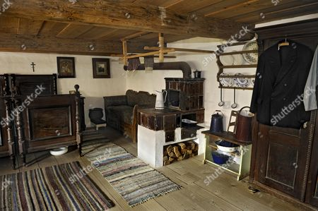 Bedroom with a tiled stove, Bernoeder Hof farmhouse, Bauernhausmuseum Amerang farmhouse museum, Amerang, Bavaria, Germany