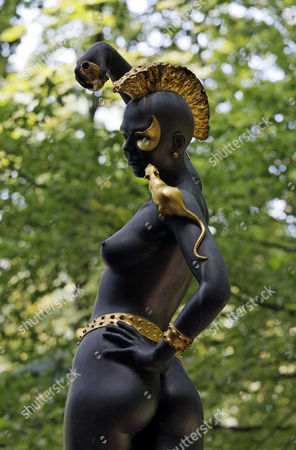 Female statue with an Iroquois haircut and a golden rat sitting on her shoulder, Ernst Fuchs Museum, former mansion of architect Otto Wagner, Vienna, Austria