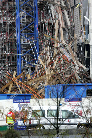 Three workers have been seriously injured after scaffolding collapsed at a construction site in the centre of Milton Keynes. Two walls collapsed causing scaffolding from 14 floors up to fall. One of those injured is undergoing surgery, said a hospital spokesman. Thames Valley Chief Inspector Andy Stanton said the fire brigade had used heat-seeking equipment to search the site but more specialist equipment was on the way.