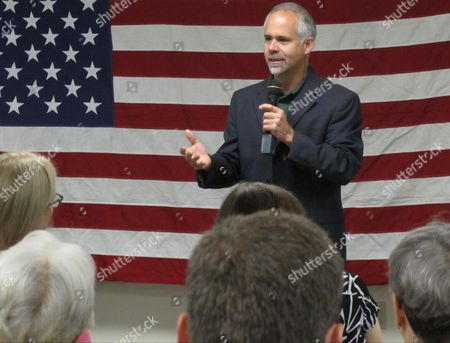 Stock Image of U.S. Rep. Tim Huelskamp, R-Kan., speaks during a campaign town hall meeting at the headquarters of Patriot Outfitters, which sells firearms, accessories and hunting and military gear in St. Marys, Kan. Huelskamp is locked in a tough GOP primary race against Roger Marshall, a Great Bend obstetrician