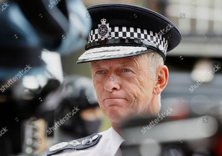 Metropolitan Police chief Bernard Hogan-Howe is interviewed during a media opportunity in London, . London's police force is putting more armed officers on the streets 'to protect against the threat of terrorism.'' The increase in the number of officers follows attacks in France, Belgium and Germany