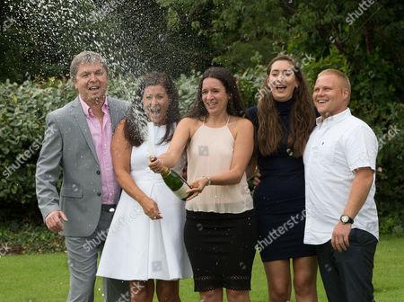 EuroMillions Jackpot winners, left to right, Keith Reynolds, Sonia Davies, Stephanie Davies, Courtney Davies and Steve Powell celebrate their £61 million pound jackpot win