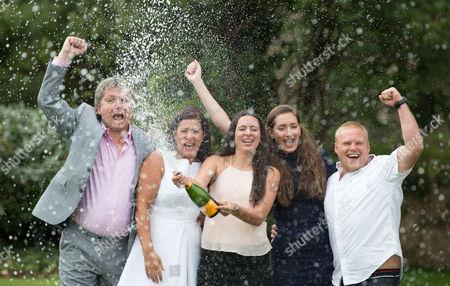 EuroMillions Jackpot winners, left to right, Keith Reynolds, Sonia Davies, Stephanie Davies, Courtney Davies and Steve Powell of Monmouth celebrate their £61 million pound jackpot win