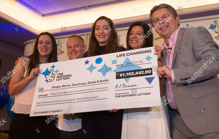 EuroMillions Jackpot winners, left to right, Stephanie Davies, Steve Powell, Courtney Davies, Sonia Davies and Keith Reynolds of Monmouth celebrate their £61 million jackpot win