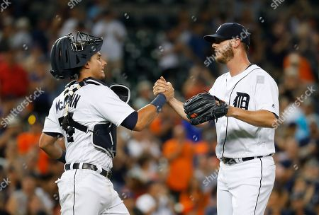 Stock Photo of Detroit Tigers catcher James McCann (34) congratulates relief pitcher Mark Lowe after the Tigers defeated the Chicago White Sox 11-5 in a baseball game  in Detroit
