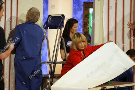 Paul O'Grady and Cynthia Lennon attempting to set a Guinness World Record for wallpapering. They fail.