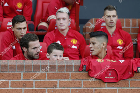 Kai Rooney takes his place on the substitutes bench with  Juan Mata  and Marcos Rojo during the Wayne Rooney testimonial match between Manchester United and Everton played at Old Trafford, Manchester on August 3rd 2016