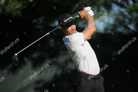 Camilo Villegas tees off on the tenth hole during the Travelers Golf Championship at TPC River Highlands in Cromwell, Connecticut