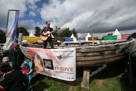 Stock Picture of Liam Ross performs on the Shipping Forecast stage