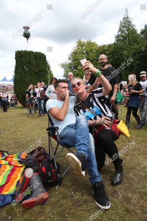 The LaFontaines - Kerr Okan performs seated beside a festival-goer