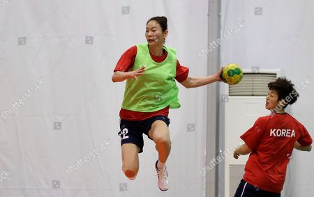 South Korea's Woo Sun-hee tries to score during a women's handball training session at the 2016 Summer Olympics in Rio de Janeiro, Brazil