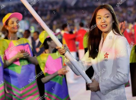 Stephanie Au carries the flag of Hong Kong during the opening ceremony for the 2016 Summer Olympics in Rio de Janeiro, Brazil