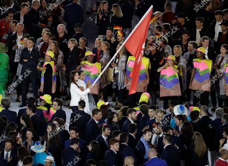 Stock Image of Stephanie Au carries the flag of Hong Kong during the opening ceremony for the 2016 Summer Olympics in Rio de Janeiro, Brazil